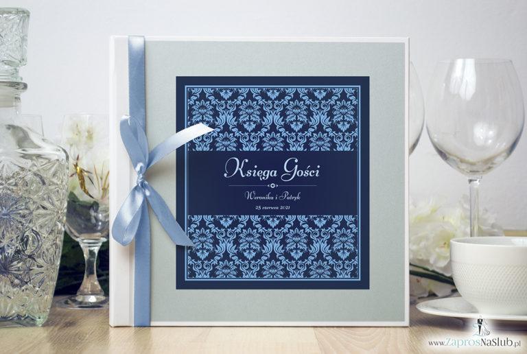 Bardzo elegancka księga gości z niebieskim motywem barokowym, błękitnym papierem perłowym. KSG-10011 - ZaprosNaSlub
